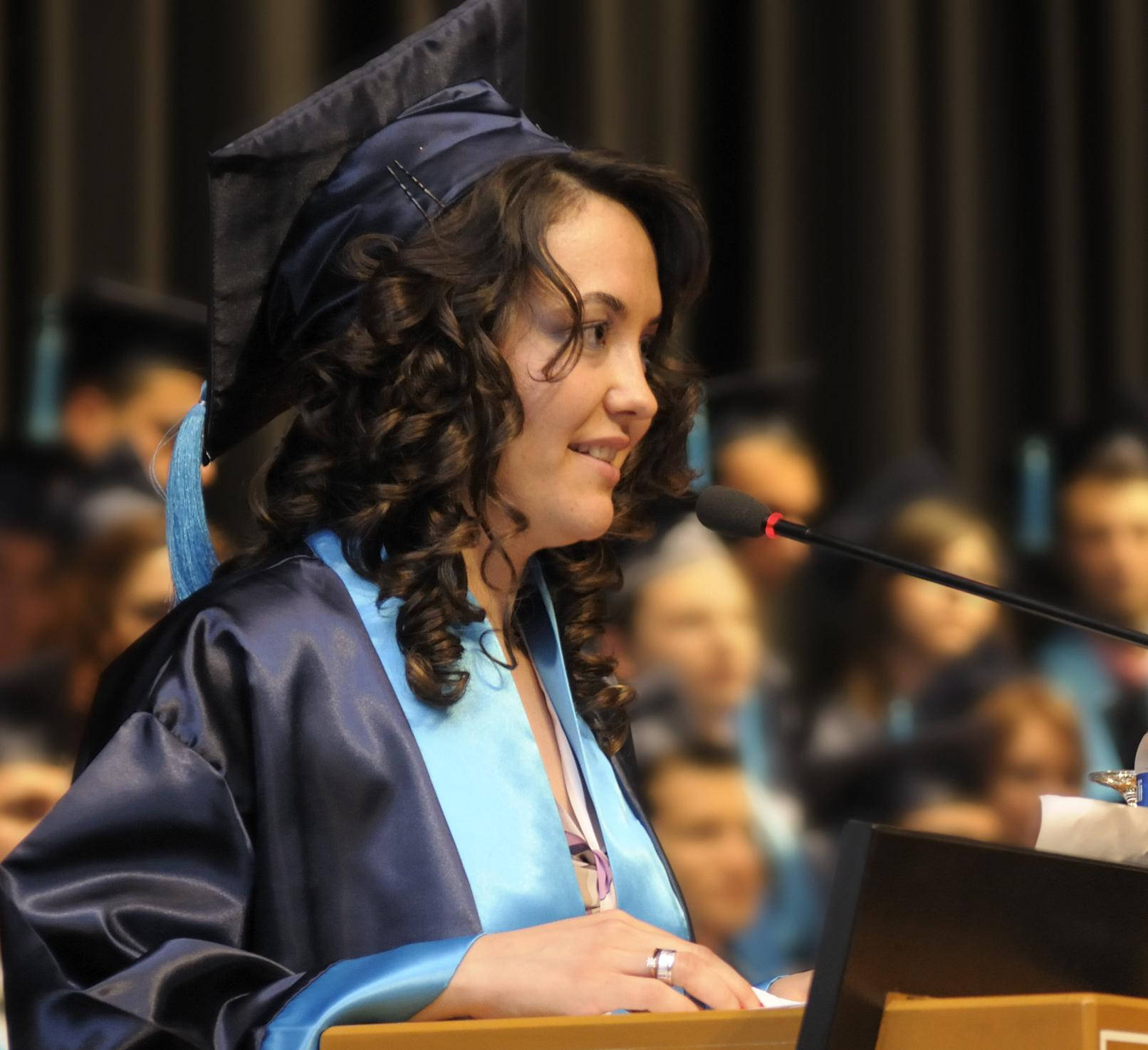 young woman speaking at college graduation